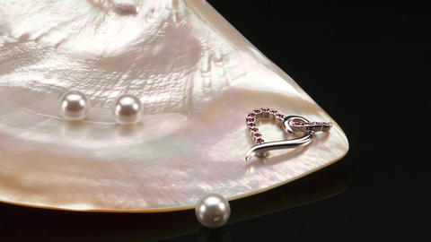 Jewellery and Pearls in a Still-life with a Polished Seashell Footage