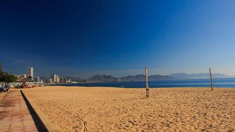 camera moves past beach with sunshade parasols at dawn Footage