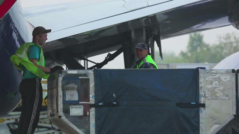 Unloading luggage from the plane Footage