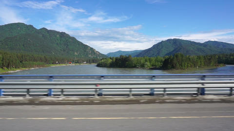Katun River view from car moving across the bridge Footage