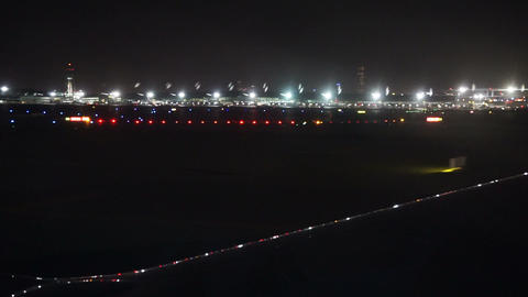 View from the plane on the airfield at night Footage