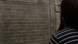 Girl Looking At Sumerian Inscriptions Footage