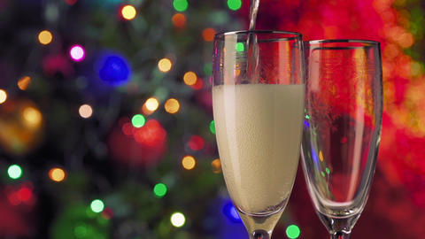 New Year and Christmas Celebration. Champagne Glasses over Blinking Background Footage