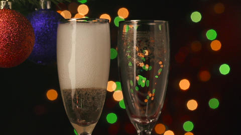 Two champagne glasses with pouring champagne Footage