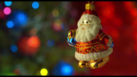 Christmas santa toy decor with new year tree lights twinkling Footage