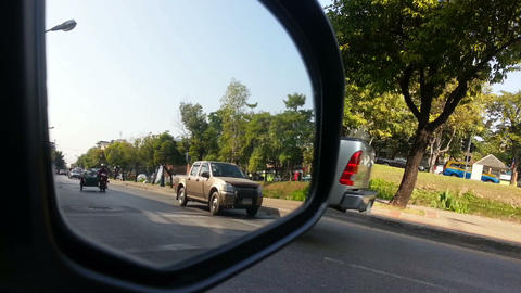 Street view from car side mirror. Let all the cars pass by Footage