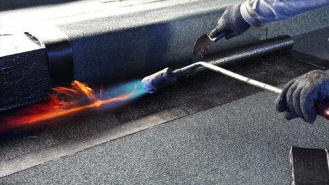 asphalt roof coating with fire, bitumen water protection layer Footage