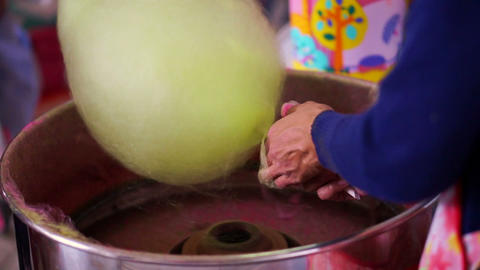 Spinning green cotton candy machine making candy close up Footage