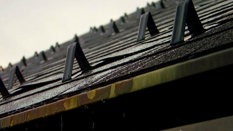 rain dropping and dripping on house roof and gutter Footage