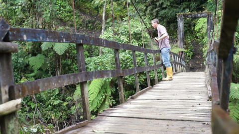 Man Looking Over Hanging Bridge Footage