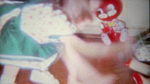 1963: Creepy blow up doll toy for little girl playing indoors at home Footage