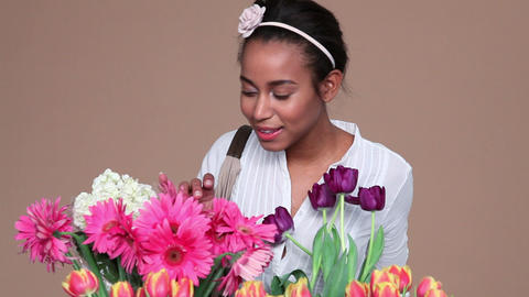 Young woman choosing flowers Stock Video Footage
