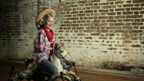 Young girl rocking on rocking horse Stock Video Footage