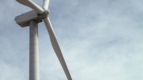 Slow motion shot of wind turbine moving Stock Video Footage