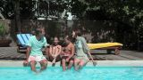 Family On Edge Of Swimming Pool stock footage