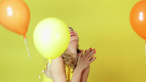 Young woman in party hat and floating balloons Stock Video Footage