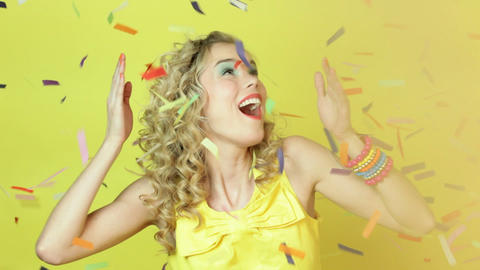 Young woman being surprised by confetti Stock Video Footage