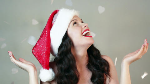 Christmas confetti and young woman in santa hat Stock Video Footage