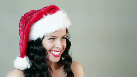 Young woman in santa hat being surprised Stock Video Footage