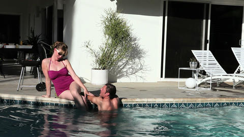 Couple in outdoor swimming pool Stock Video Footage