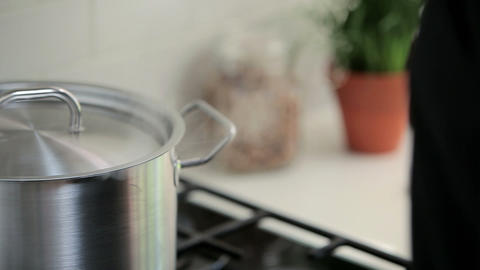 Saucepan on hob Stock Video Footage