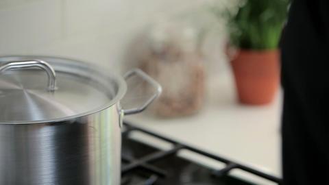 Saucepan on hob Stock Video Footage