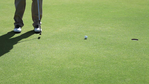 Mature man playing golf, low section Stock Video Footage