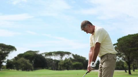 Mature man playing golf on golf course Stock Video Footage