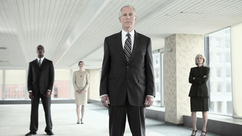 Businesspeople standing still in office Stock Video Footage