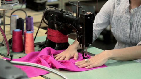 Young woman using sewing machine Stock Video Footage
