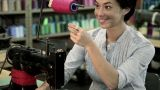 Young woman using sewing machine Footage
