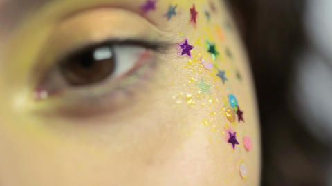 Close up of female eye with yellow make up and star... Stock Video Footage