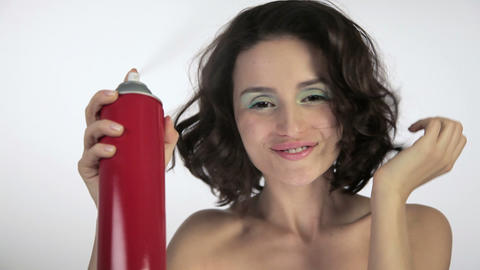 Young woman using hairspray Stock Video Footage