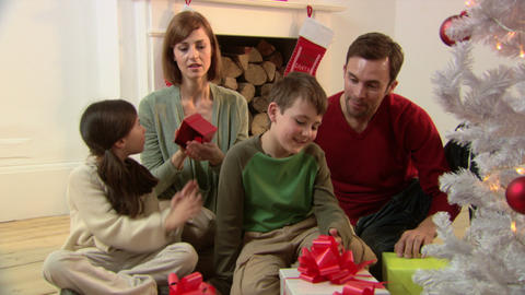 Family looking at christmas gifts Stock Video Footage