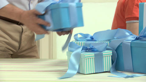 Man giving gift to grandson Stock Video Footage