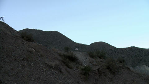 Camera panning to show four mountain bikers on top of hill Stock Video Footage