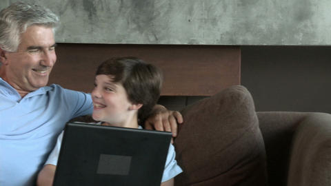 Boy and grandfather with laptop Stock Video Footage