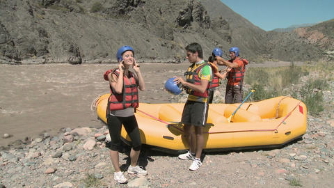 Young people preparing for white water rafting Stock Video Footage