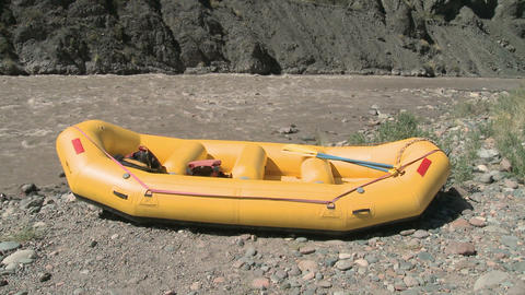Man and woman putting on lifejackets ready for rafting Stock Video Footage