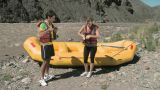 Man and woman putting on lifejackets ready for rafting Footage