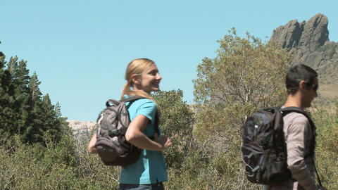 People hiking through rural landscape Stock Video Footage