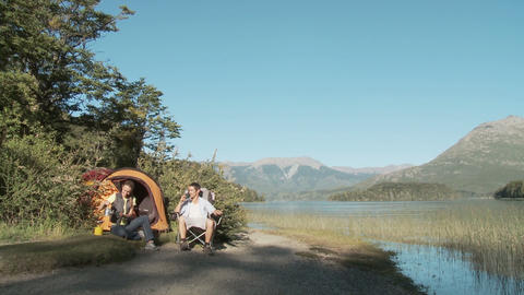 Couple camping by a lake Stock Video Footage
