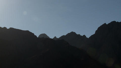 Sunlight over mountain landscape, zoom out Stock Video Footage