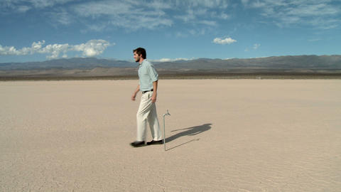 Man using faucet in desert landscape and finding there is... Stock Video Footage