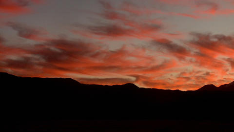 Clouds and sunset over mountain landscape Stock Video Footage
