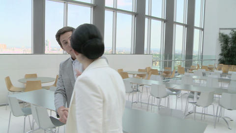 Businesswoman walking through canteen and shaking hands... Stock Video Footage