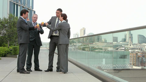 Businesspeople outdoors, toasting with bucks fizz Stock Video Footage