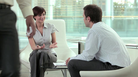 Businesswoman and businessman talking Stock Video Footage