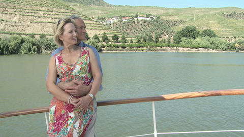 Senior couple embracing on a boat holiday Stock Video Footage