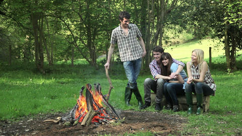 Young adult friends by a campfire Stock Video Footage